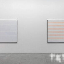Installation photograph of Agnes Martin's 'Happy Holiday' and 'Faraway Love' at Tate Modern's Agnes Martin Exhibition, 2015.